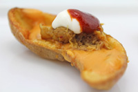 Fingerling Potato Skin with Pulled Pork and Nacho Cheese