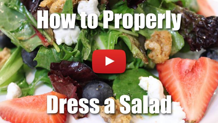Learn how to properly dress a salad using oil and vinegar.